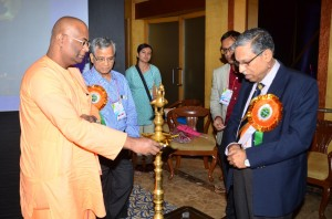 Swami Sebabratanada Maharaj of Ramkrishna Mission Seba Pratisthan, Prof Samar Banerjee and Dr. Sudarshan Chakraborty lighting the lamp to inaugurate the conference.