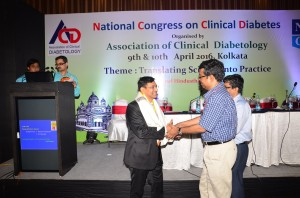 Dr. Sunil Gupta receiving Young Achievers award from Dr. P.S. Mondal and Dr.Tanmoy Chatterjee.
